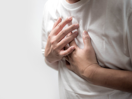 Man suffering from chest pain on white background, Health care Banco de Imagens