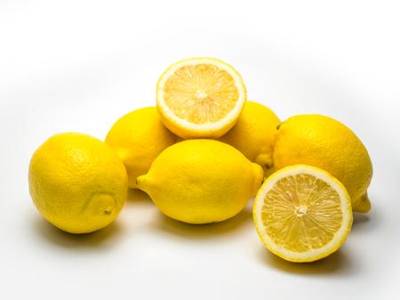 Group of ripe whole yellow lemon citrus fruit with lemon fruit half isolated on white background Фото со стока