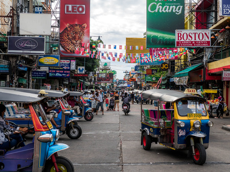 Bangkok, Thailand - August 19, 2018: Khao San Road, famous tourist destination and popular tourist in Bangkok, with cheap accomodations and a lot of bars, crowded at night with people partying.