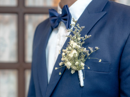 detail of the suit of a groom with a flower.