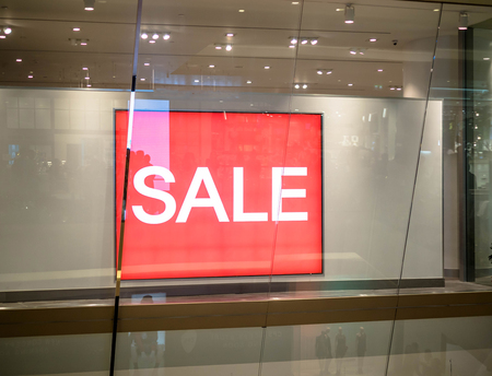 Shop display window and sale sign, sale borad
