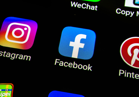 Bangkok, Thailand - June 15 2019: Macro photo of Facebook icons on a smartphone screen. Facebook is the biggset online social networking service in the world.