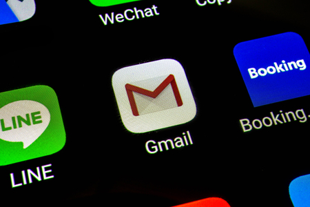 Bangkok, Thailand - June 15 2019: Macro photo of Google Gmail application icon on a smartphone screen. Gmail is popular Internet online e-mail. Social media icon.