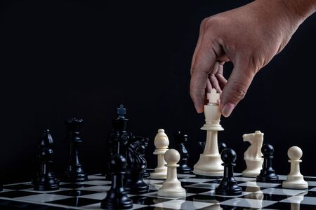Chess with games of business. Businessman holding leader for fight.