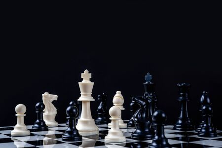 One chess pieces staying against thel set of chess pieces. Strategy, Chess with games of business, business concept.