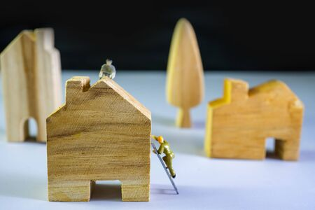 Small figure worker and House model. House building concept