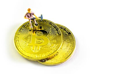 Golden Bitcoin and Small figure worker. Bitcoin concept. copy space background for text