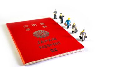 Japanese passport and Small figure people. Travel to the country. 写真素材