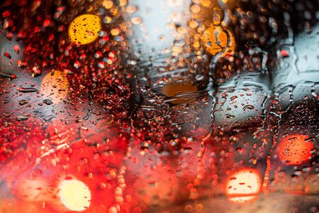 Traffic Jam with raining in evening day , focus on the rain drop of car window 写真素材
