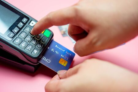 Moment of payment with a credit card through terminal, Buy and sell products & service,selective focus, Finance concept.