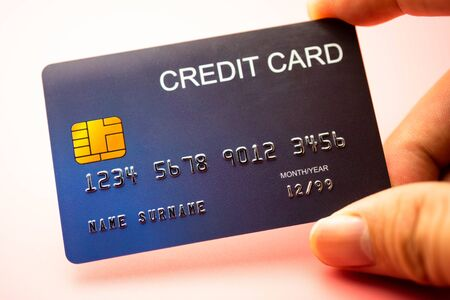 Hand holding credit card, Finance concept.