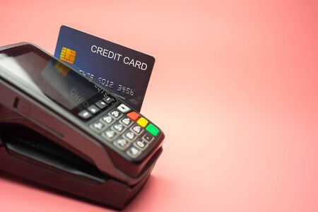Moment of payment with a credit card through terminal, Finance concept. 写真素材