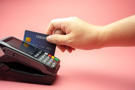 Hands swiping Credit card on Credit card machine or Credit card Terminal, Finance concept. 写真素材