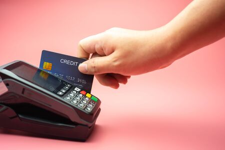 Man Hands swiping Credit card on Credit card machine or Credit card Terminal, Finance concept.