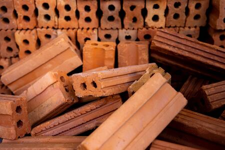A group of bricks square construction materials. pile of red brick