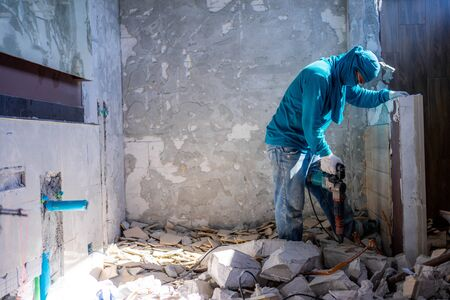 Men worker are extracting structure concrete floor.  Hard work. Reklamní fotografie