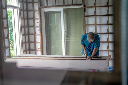 Chiang Mai, Bangkok - 5 November 2019: Shot of old master carpenter working in his woodwork or workshop. Фото со стока