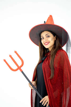 Happy Halloween Witch with bright make-up and long hair.