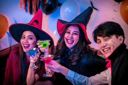 Young People in Costumes Celebrating Halloween.