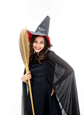 Happy Halloween Witch with bright make-up and long hair on white