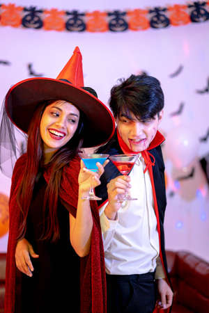 Portrait of Young Couple in Halloween Costumes.
