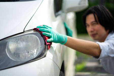Car detailing - Shot of A man cleaning car with microfiber cloth, Selective focus. Standard-Bild