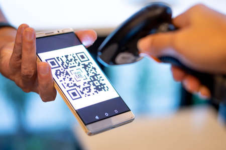 barcode scanner scanning qr code on smartphone for e-payment, online shopping, cashless technology concept.