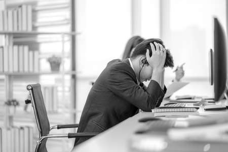 Businessman are stressed while overtime working. Serious and tired working, Upset tired man, office employee lying on table, dozing off exhausted bored.