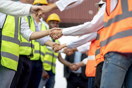 Architects shaking hand at construction site, Finishing successful meeting. Imagens