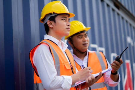 Engineer staff team checking and inspect container for international business logistic import and export concept. transportation import, export logistic industrial service.