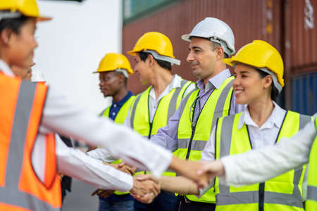 Construction Engineering Team are Handshake Together After Dealing Their Project Successful, Finishing successful meeting.