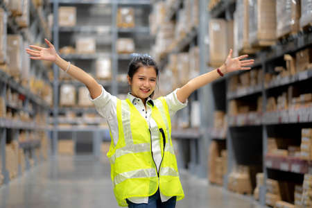 Shot of cheerful positive warehouse workers in storage department. Happy people while taking a break.