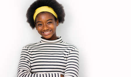 Cute multiracial african girl with an afro hairstyle wearing casual clothes smiling - Isolated on a white nackground, Positive emotions.