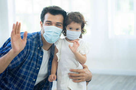 Father and daughter wear face masks, both are wearing face masks for confidence in their health.  protect themselves from dangerous spread of coronavirus covid-19.