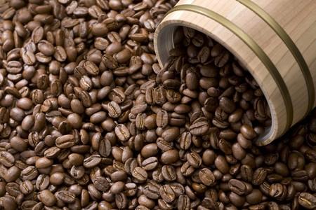 horizontal format horizontal: Coffee bean out of oak drum horizontal format