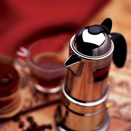 Espresso pot and cup of coffee  photo