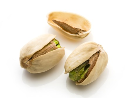Salted pistachio on white background