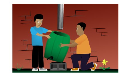 A father and son install a rain barrel to a house gutter. A rain barrel improves water conservation by diverting rainwater from the sewers for use in a garden or other non-potable water use.