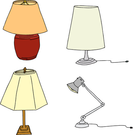 Group of four modern table lamps on white background