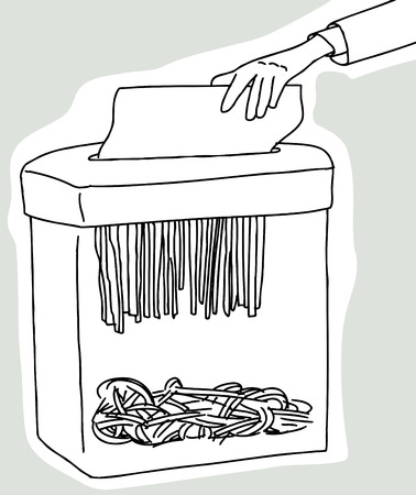Hand placing document in document shredder on gray background