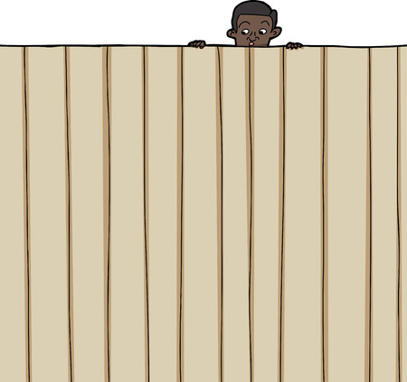 watchful: Amazed male child looking over wooden fence