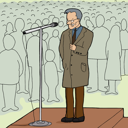 Mature man with microphone talking to audience