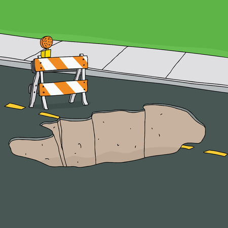 erosion: Reflective traffic barricade in front of large sinkhole