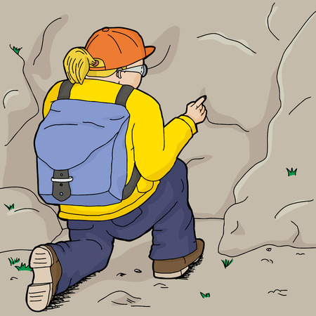 ajoelhado: Caminhante no ajoelhar amarelo e apontar em rocha