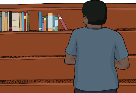 wooden shelf: Indian male looking at books on wooden shelf