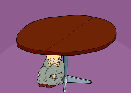 anxious: Crying child sitting underneath a round table