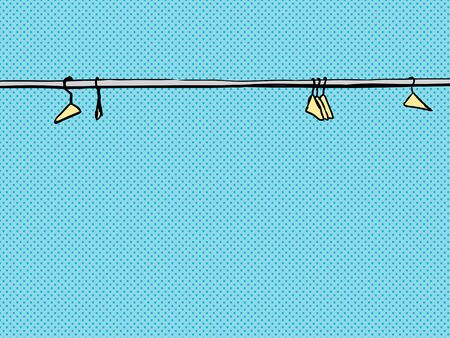 clothes hangers: Empty clothes hangers scattered along metal rod over blue background