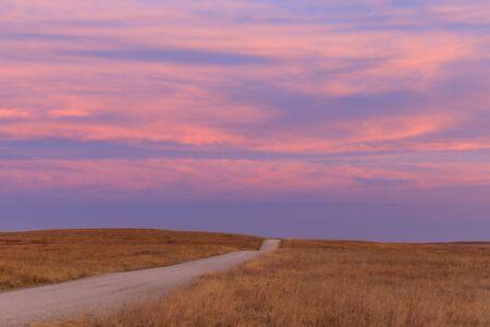 Sunrise in the distance at the Tallgrass Prairie Preserve in Pawhuska, Oklahoma