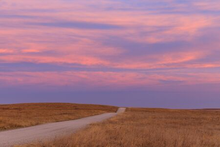 Sunrise in the distance at the Tallgrass Prairie Preserve in Pawhuska, Oklahoma