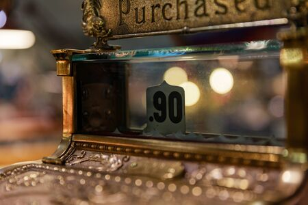 Antique cash register with ninety cents showing as a sale. Stok Fotoğraf - 96573354